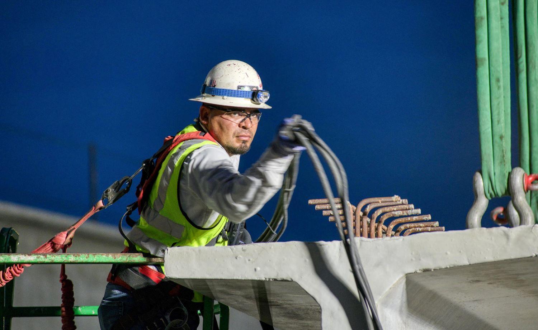 Walsh frontline workers work on bridge project