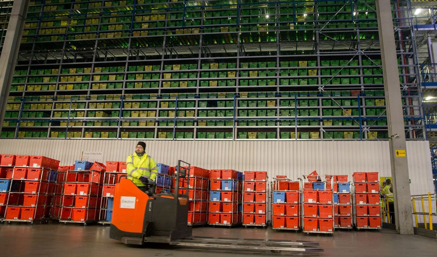 Frontline workers transport goods and mail in a warehouse