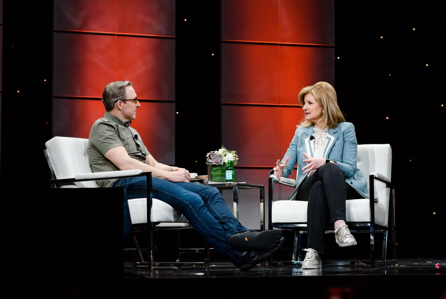 Arianna Huffington in an interview with guest on stage