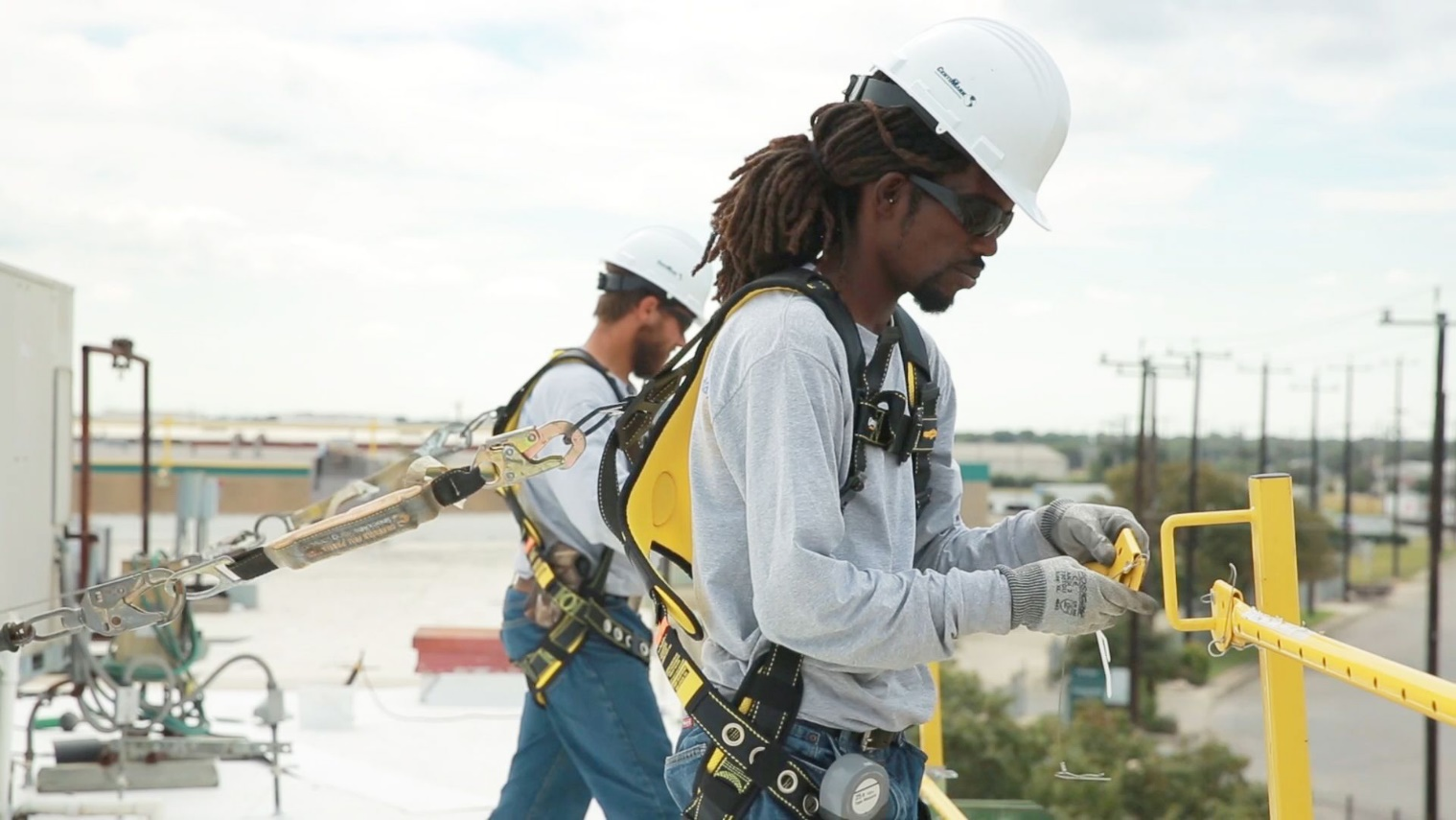 CentiMark construction team on a roof