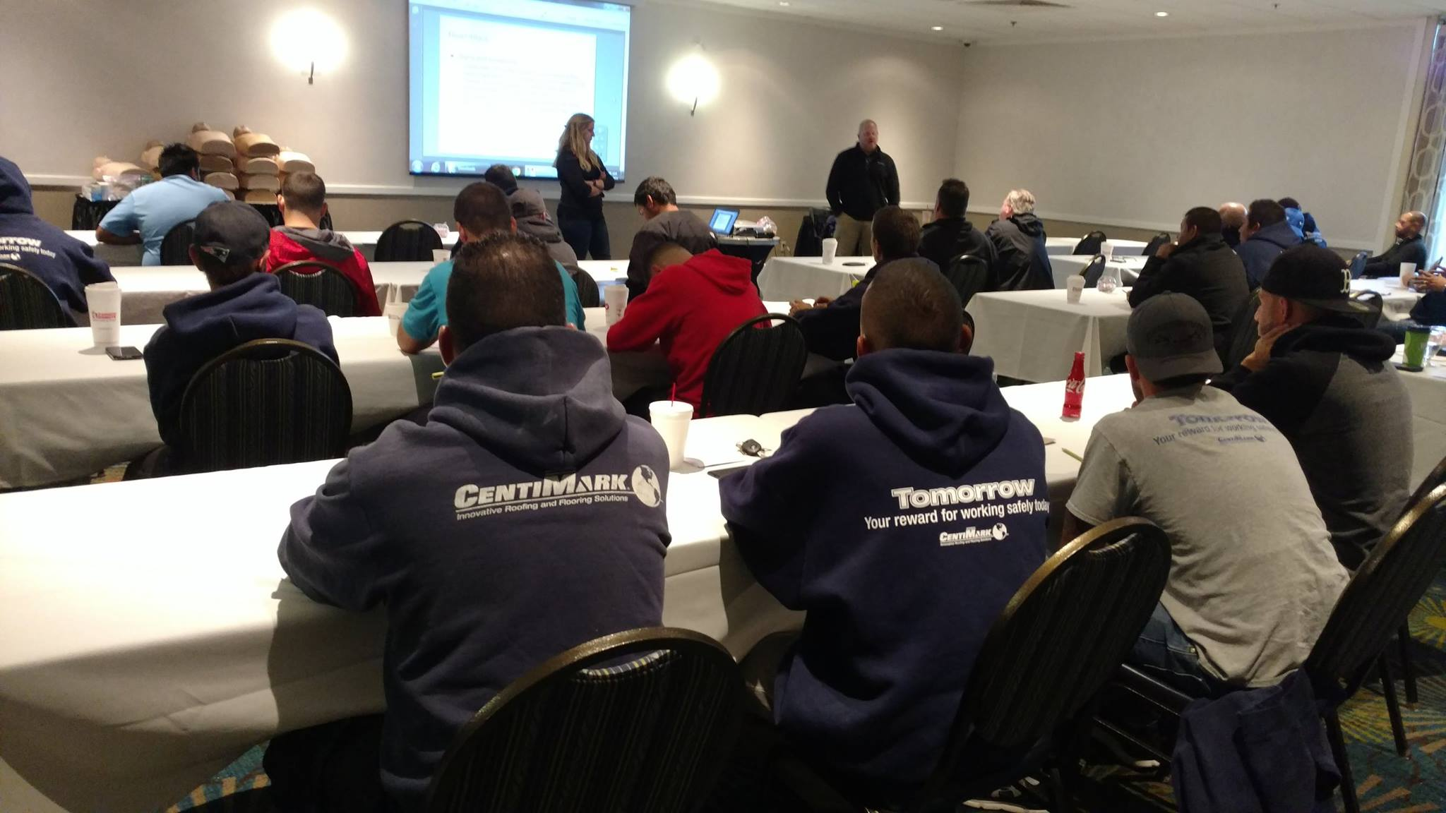 CentiMark staff speak to frontline workers in a training session