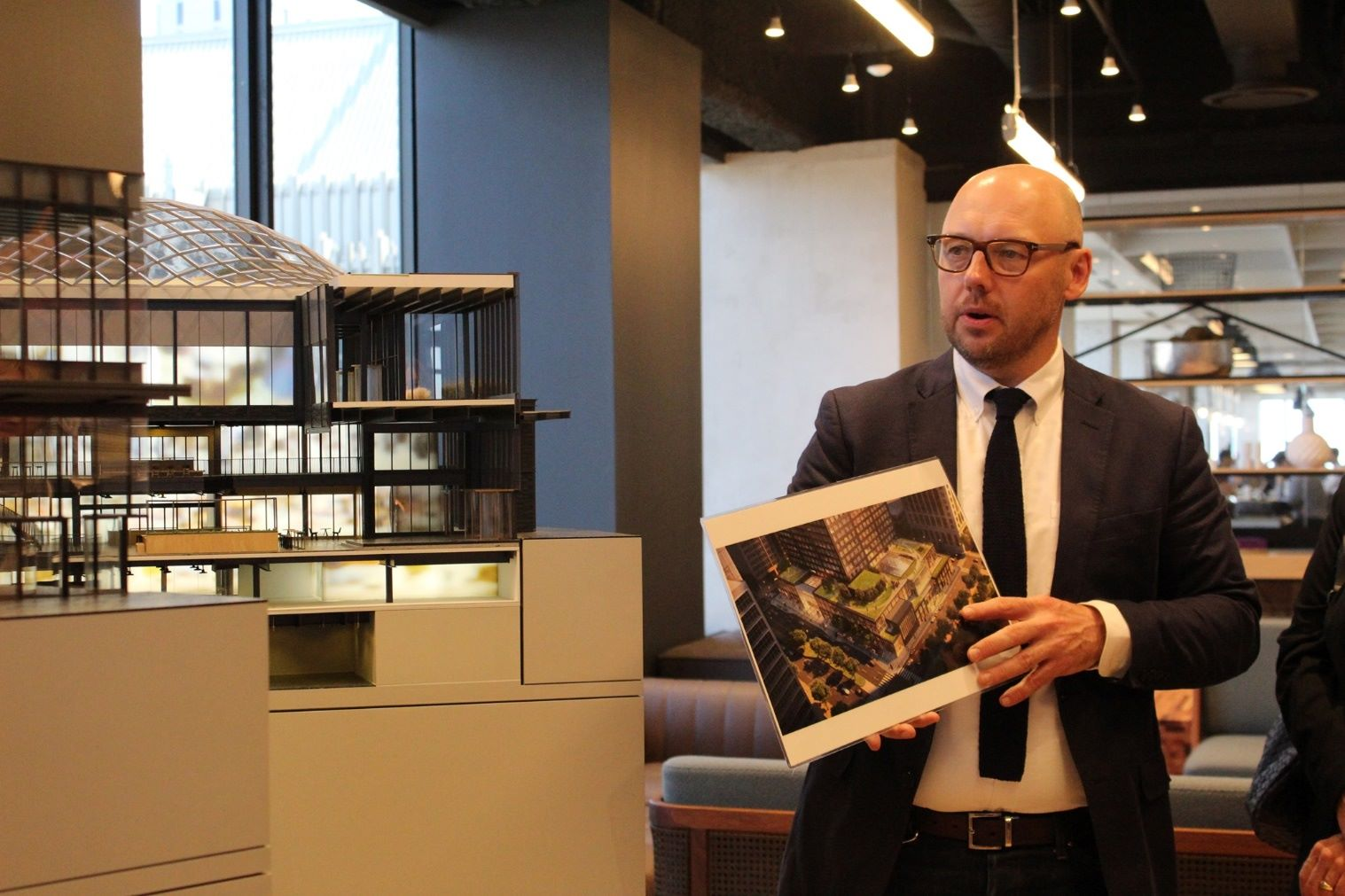 Gensler architect present to clients of the building model