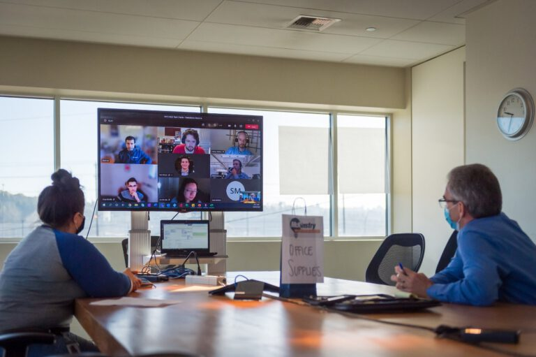 Mckinstry staff in a meeting with the remote team
