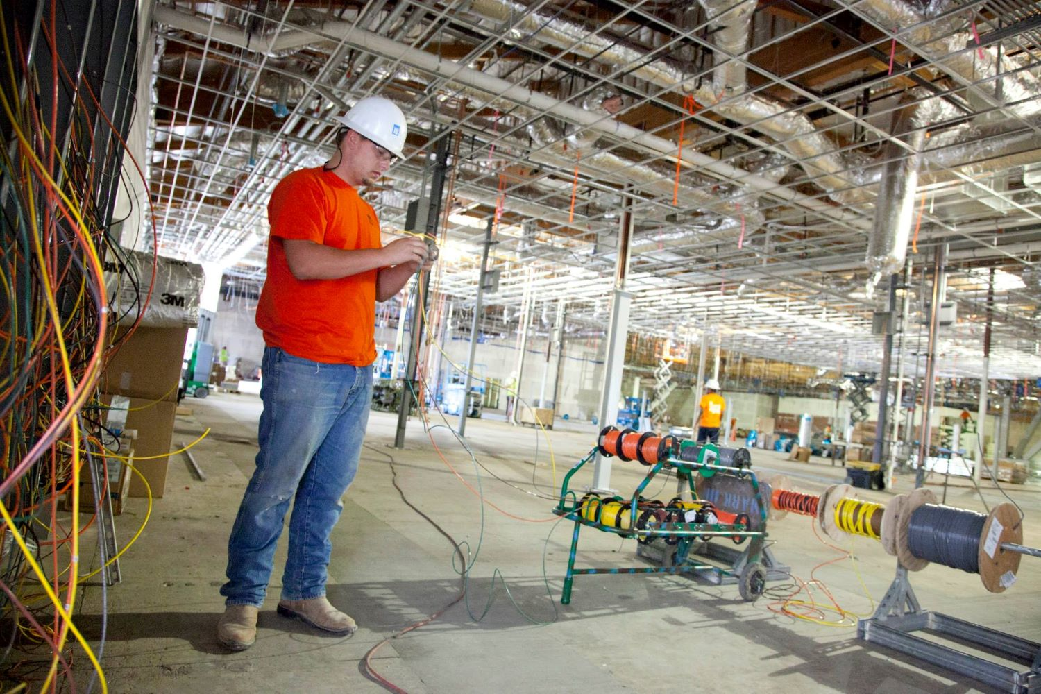 Mark III staff is wiring electrical grid in a building