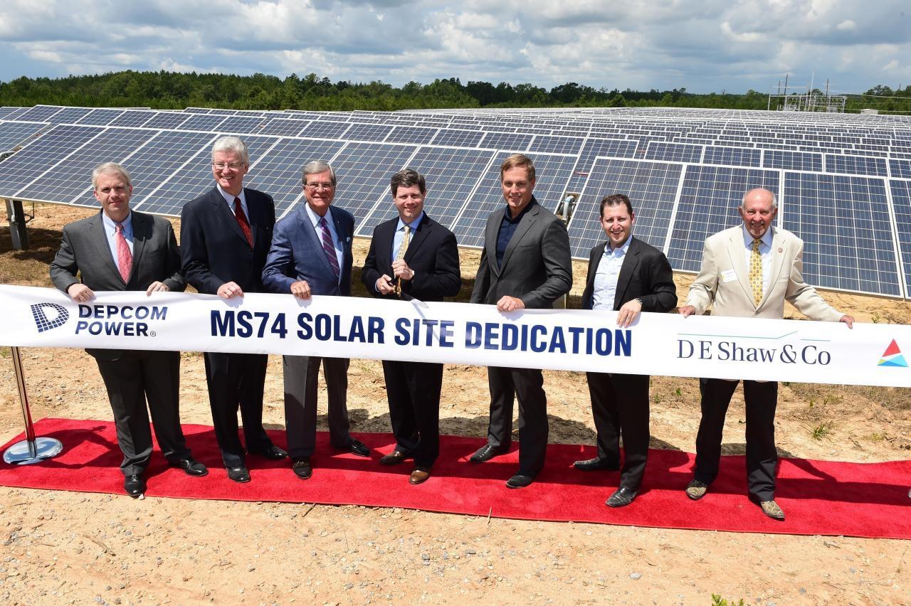 DEPCOM Power leadership at a ribbon cutting ceremony at solar farm