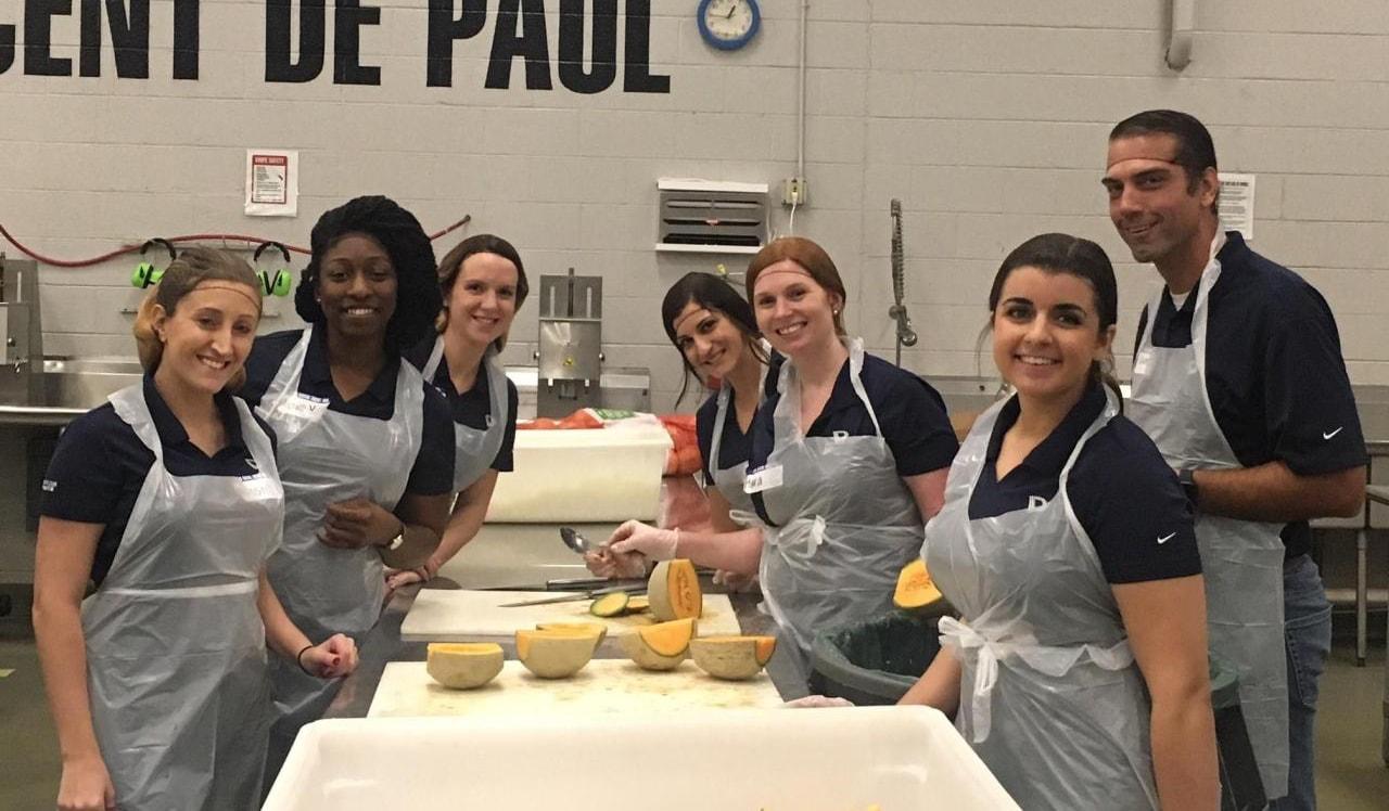 DEPCOM Power staff prepare meals at a volunteer day