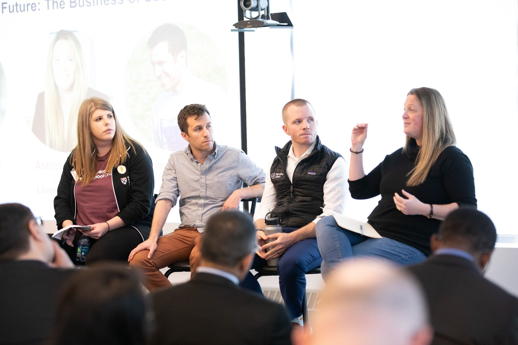 Harvard Business School staff discuss with entrepreneurs in a seminar