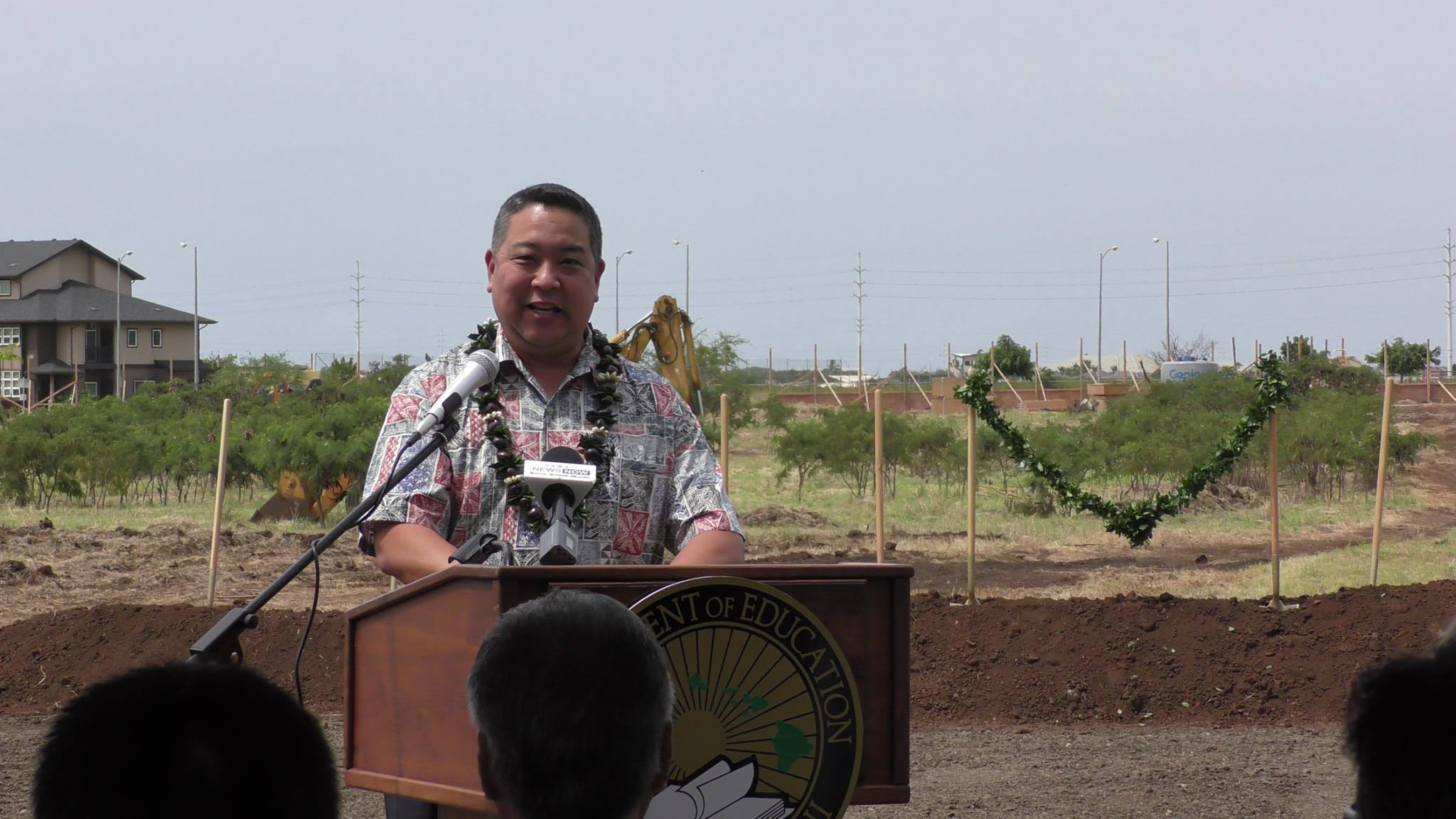 NAN leadership in a ribbon cutting with department of education