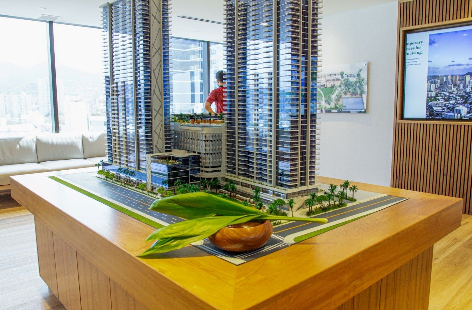 staff work on a model of complex building in Hawaii downtown