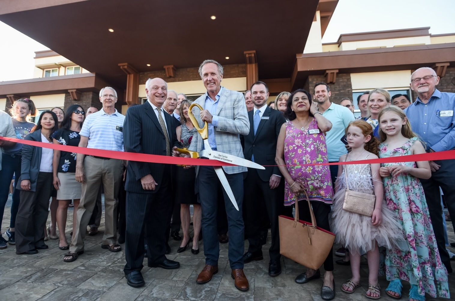 R.D Olson leadership and CEO in a ribbon cutting ceremony