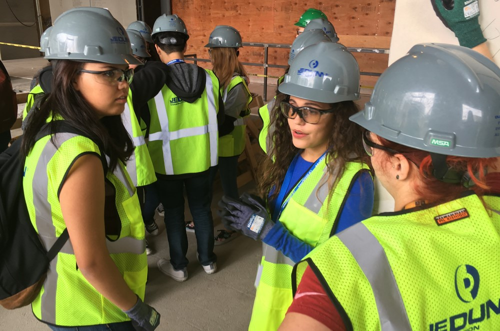 JE Dunn staff takes a tour with high school students