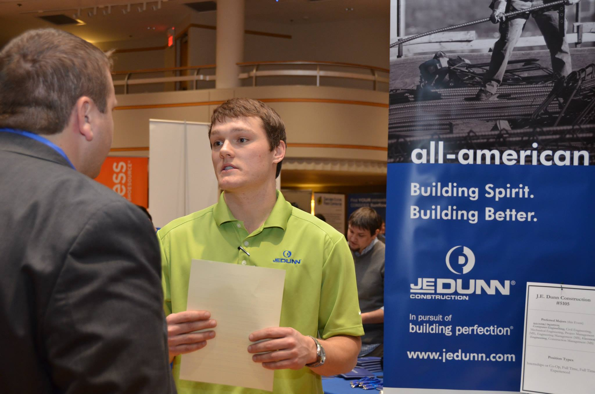 JE Dunn team at a conference