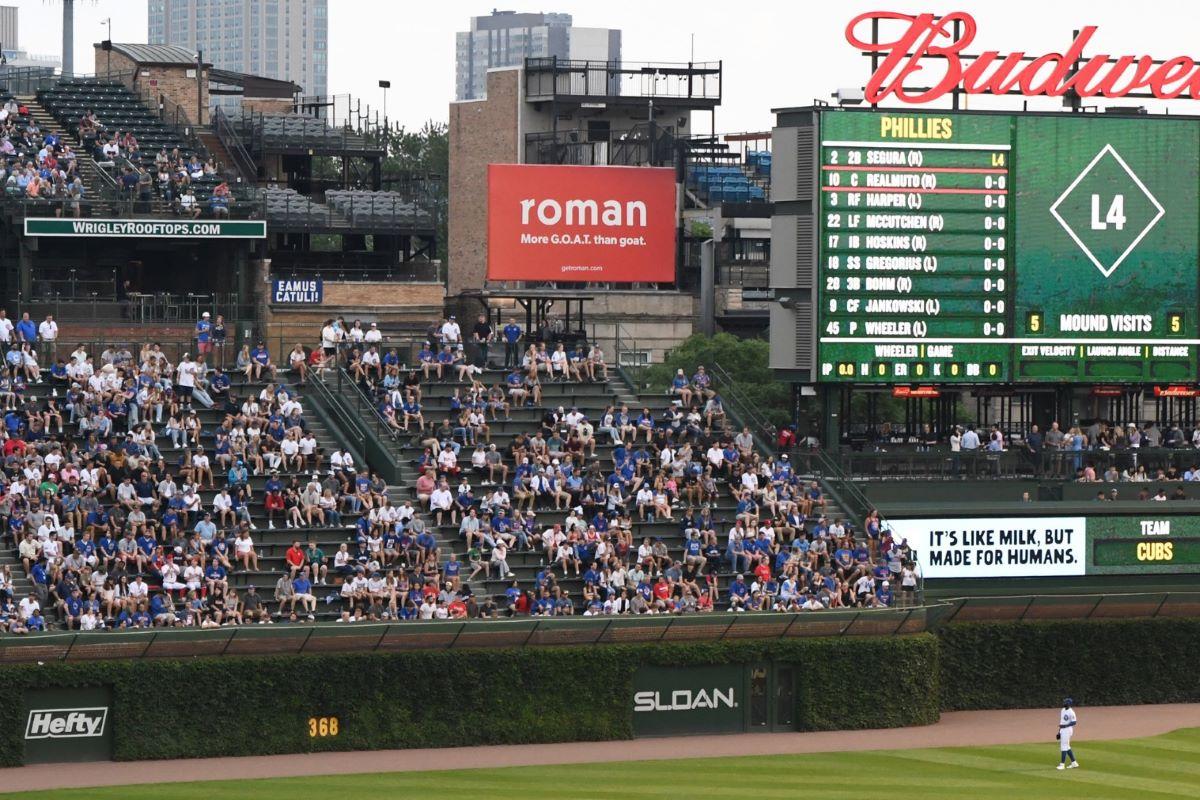 Ro sub-brand Roman ads board at a baseball field
