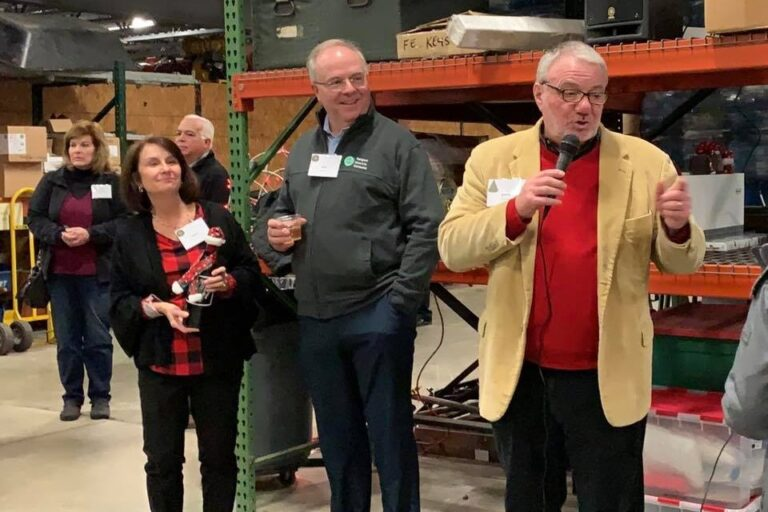 Sargent Electric leadership team collaborate at a warehouse