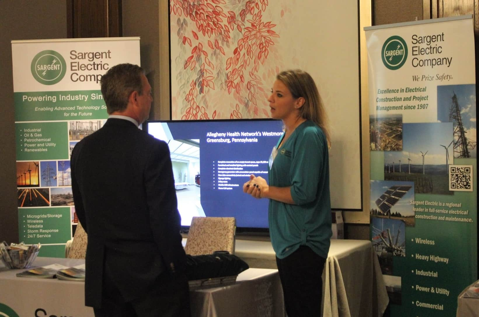 Sargent Electric staff talk to attendees at the conference