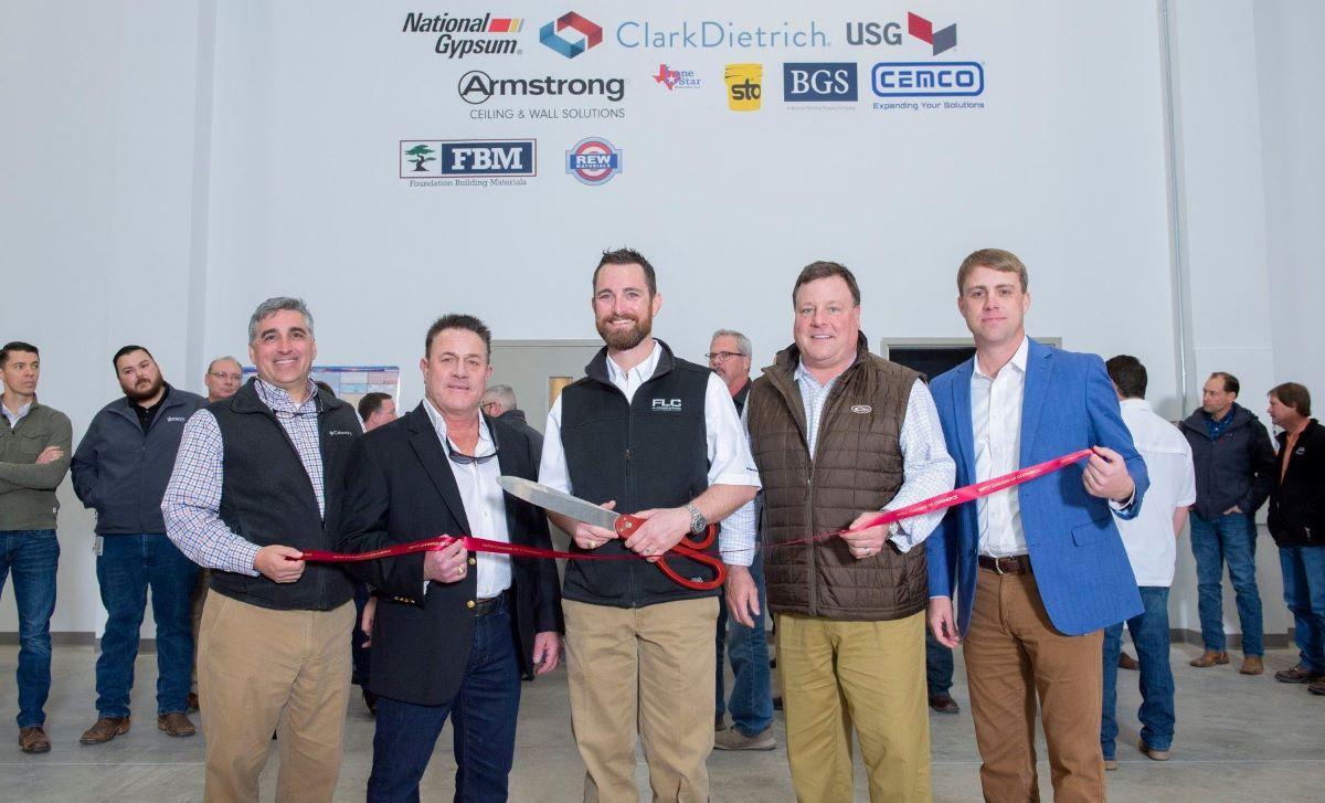 FL Crane & Sons leadership celebrate in a ribbon cutting ceremony