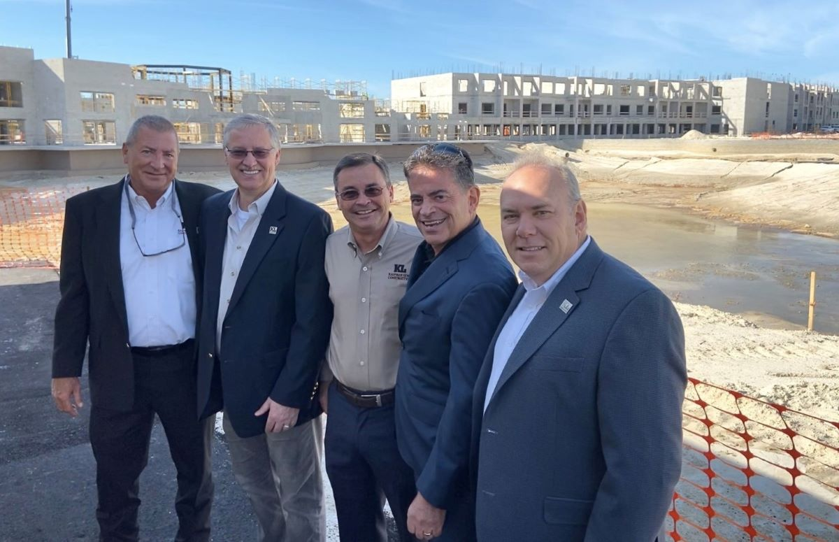 Kaufman Lynn Construction leadership team at a job site of multifamily project