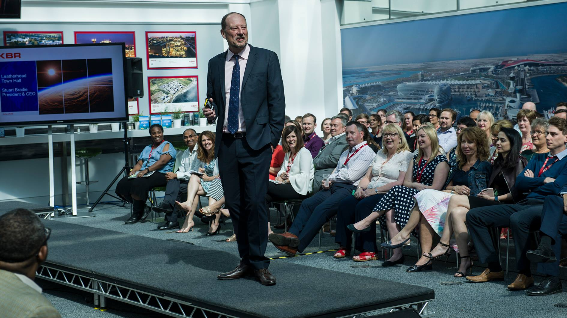 KBR CEO speak to the staff at a company event