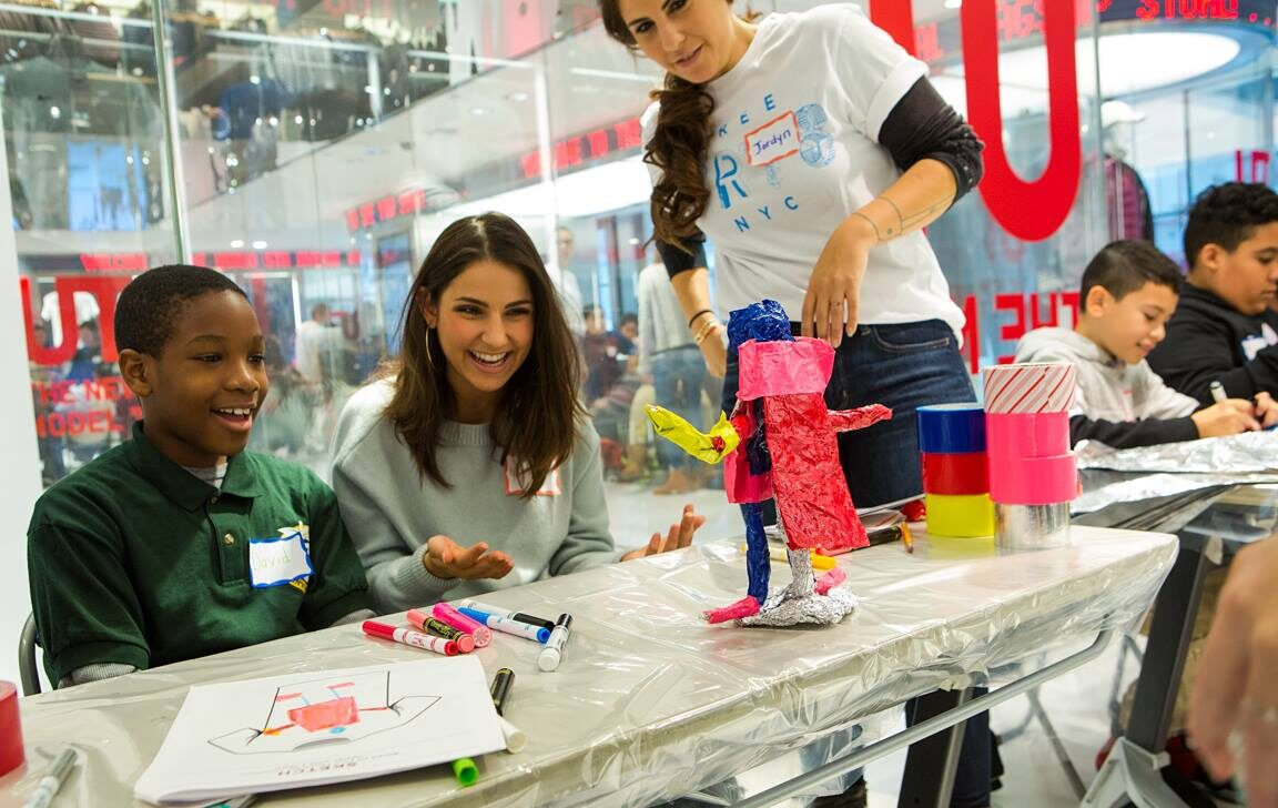 Uniqlo staff collaborate with kids on art